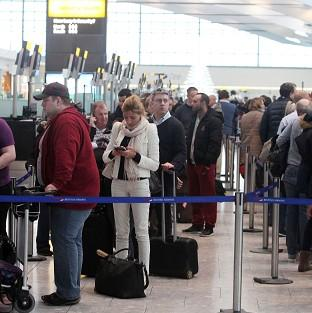 Witney Gazette: Passengers queue to check in and to rebook tickets at Terminal 5 of Heathrow Airport following a technical problem at the National Air Traffic Services (Nats) control centre in Swanwick
