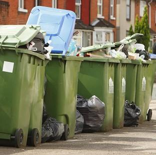 Communities Secretary Eric Pickles attacked councils trying to end weekly rubbish collections, issuing a 'bi