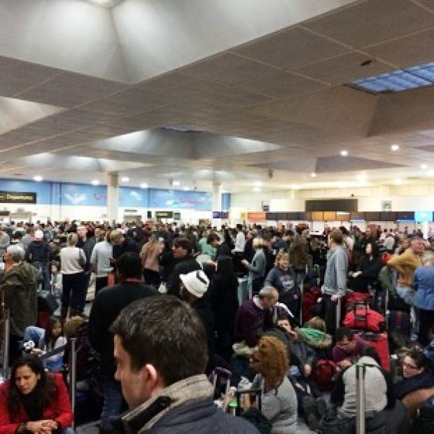 Witney Gazette: Passengers waiting at the North Terminal at Gatwick as flights were cancelled due to bad weather (Daniel Cawthorne).