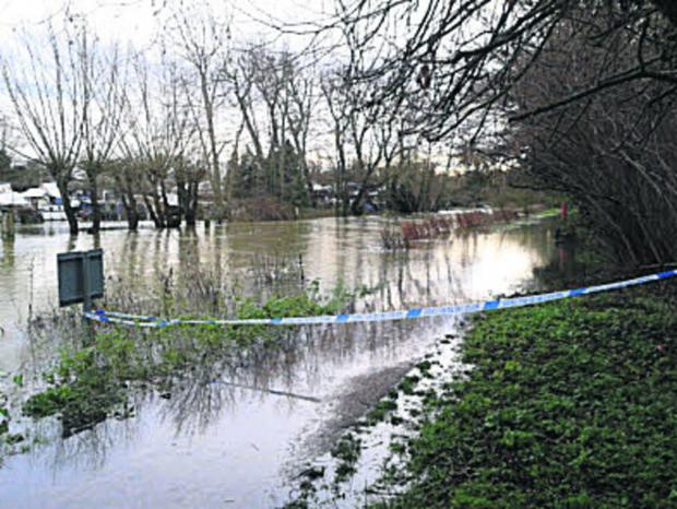 Witney Gazette: Police sealed off the towpath near Osney Lock after the incident