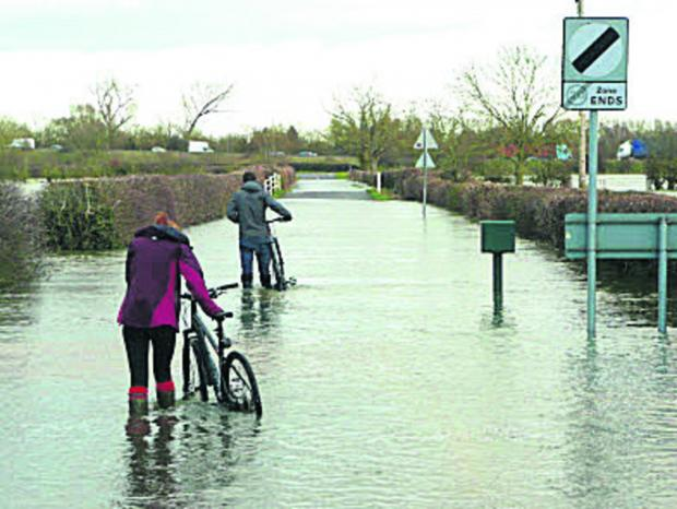 Floodwater cyclists prompt police alarm