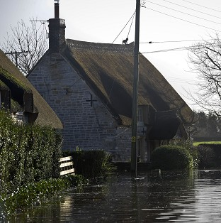 Properties near the village of Muchelney, Somerset, where residents have been relying on volunteers in boats bringing in supplies