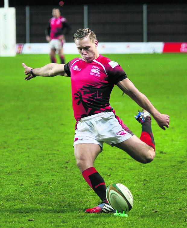 Witney Gazette: Will Robinson slots another kick