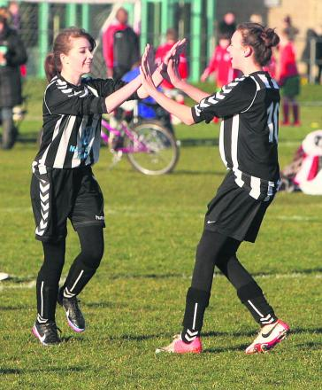 Abbie Goodall (right) is congratulated by Shauna Hawtin after scoring the first of her double in the 4-0 win at Carterton