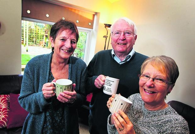 Witney Gazette: George Hedges, chairman and secretary of the charity pictured with wife Pamela, left, and friend Carole West