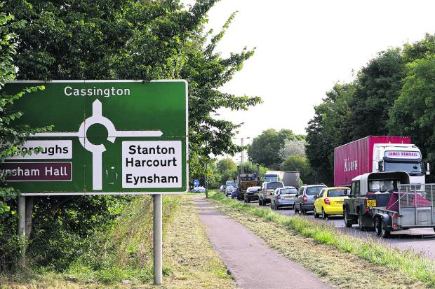 Witney Gazette: STANDSTILL: Traffic backed up on the A40 at Eynsham following an accident during rush-hour