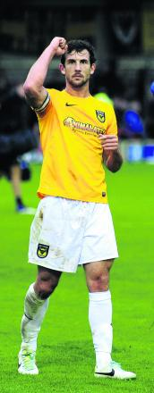 Jake Wright salutes the travelling fans at Wimbledon earlier this season. The Oxford United sk