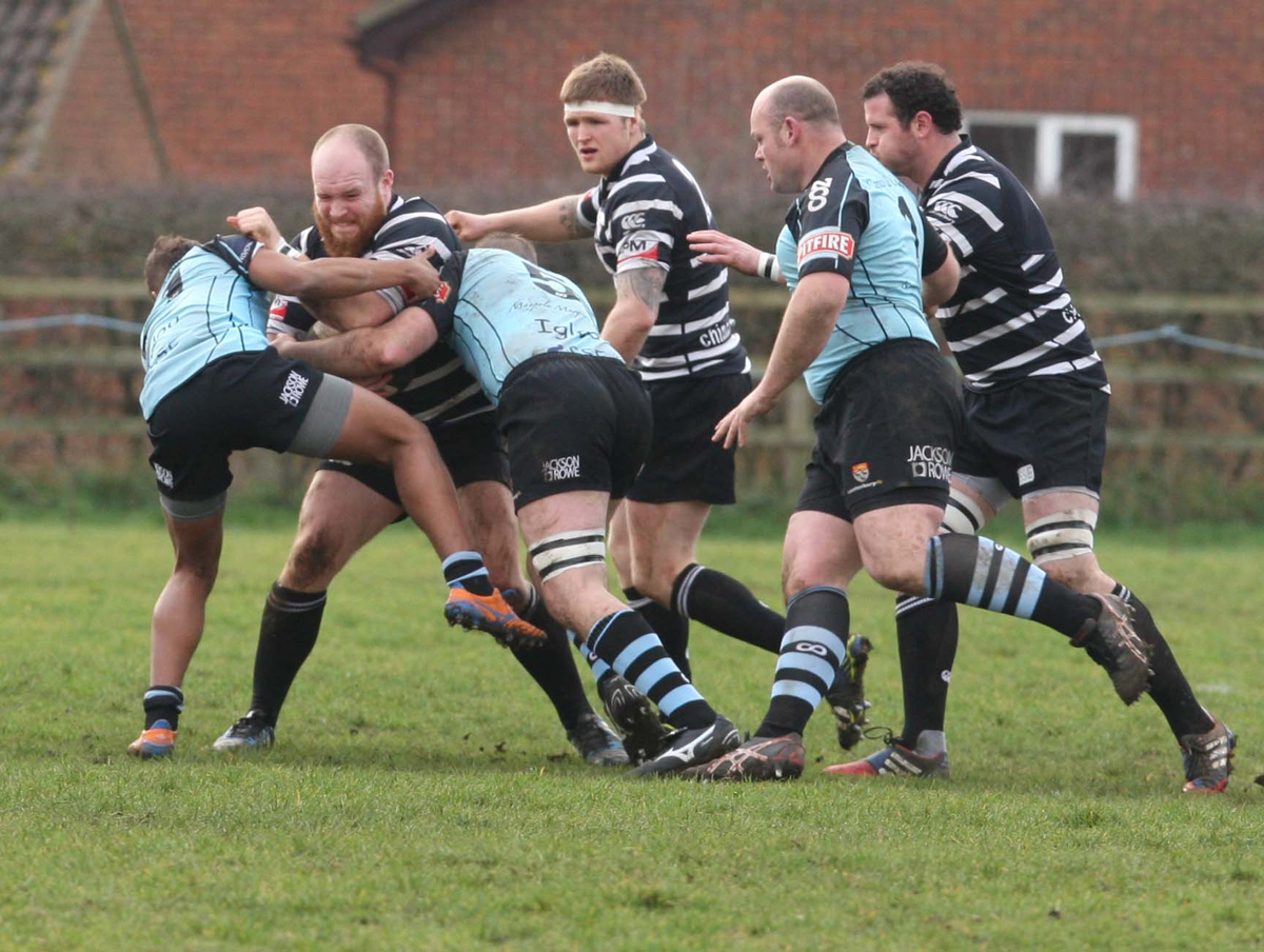 Chinnor prop Joe Pickett battles to keep the ball alive against Canterbury
