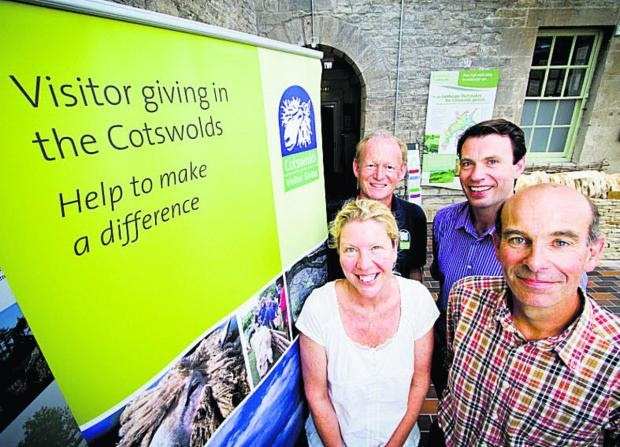 Witney Gazette: Chris Grimes, of Manor Cottages, is pictured, back, right, at the scheme's launch with, back, left, Nick Holliday, of the Cotswolds Sustainable Tourism Partnership, and, front, Susie Hunt, of Batsford Arboretum, and Harry Acland, of Notgrove Cottages