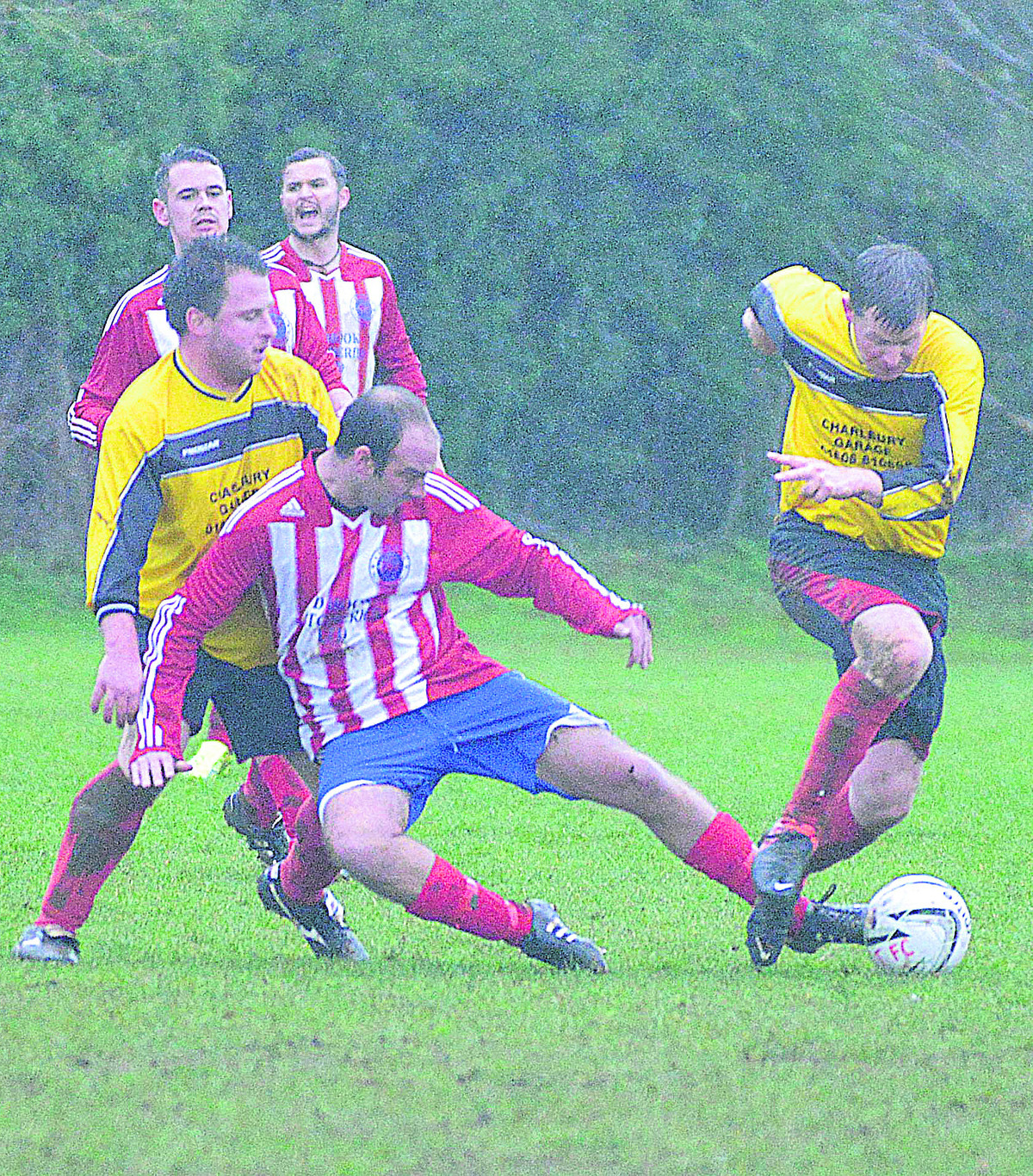 Charlbury's Steve Fitzgerald (right) wins this battle with Ben Waldron during their 2-0 home win against Aston in the Premier Division