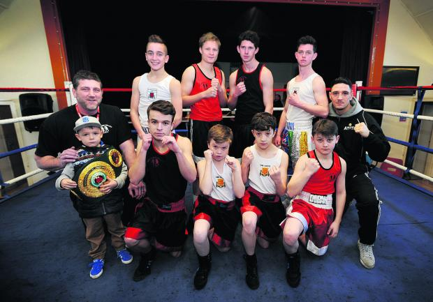 Witney Gazette: The fighters who took part in the Windrush Boxing Show. Back (from left): Nathan Hall, Lewis Townsend, Harry Connors, Tommy Connors, Kelvin Young. Front: Harrison Greeves, Zack Ryerson, Shaun Callaway, Jimmy Doran. Pictured with head coach Joe Bu