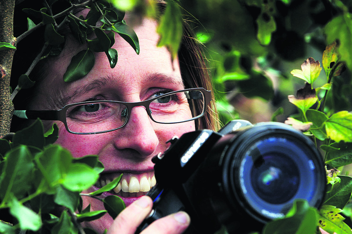 Emma Williams, from the Botanic Garden, keeps a look-out for birds