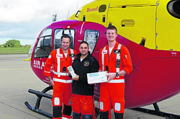 From left, paramedic Clive Stevens, Dr Syed Masud and paramedic Richard Company