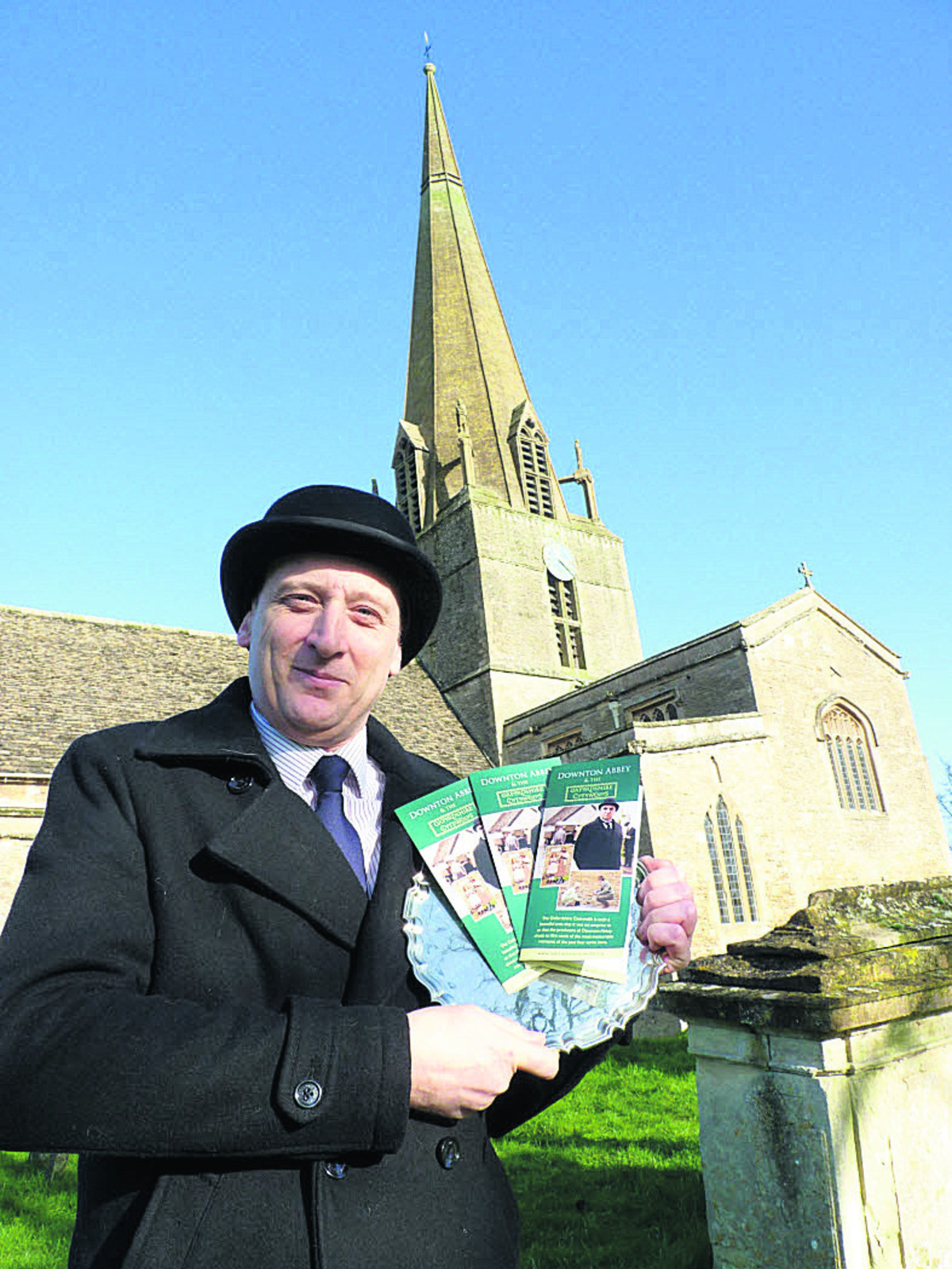 West Oxfordshire District Council tourism development officer Chris Jackson outside St Mary's Church, Bampton, one of the locations for Downton Abbey