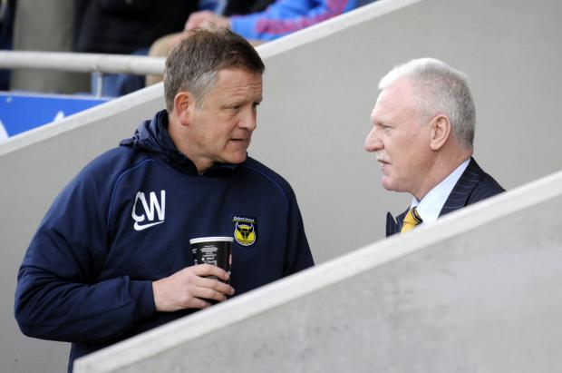 Chris Wilder and Ian Lenagan deep in conversation at an Oxford United match earlier this season