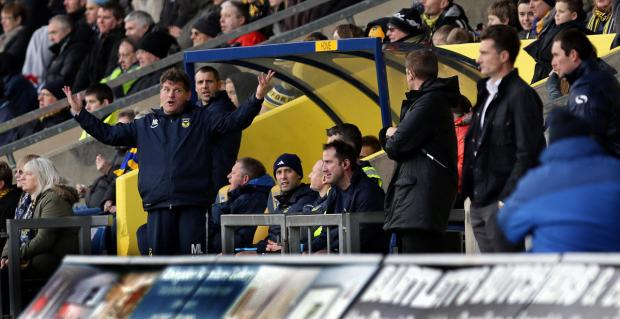 Witney Gazette: Mickey Lewis gesticulates towards the Torquay bench during Saturday's match