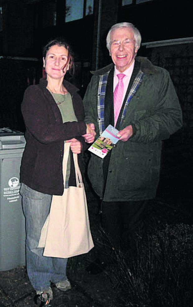 Witney Gazette: Reg Waite, of Oxfordshire Waste Partnership, is pictured presenting Ms Rhea Zambrellas with her prize