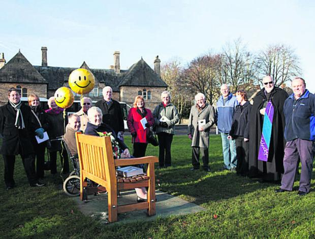 Witney Gazette: John Brooks's widow Rosemary sitting on the bench at Church Green.