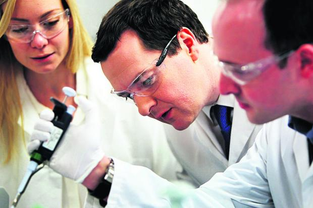 Witney Gazette: Chancellor George Osborne, centre, at Begbroke Science Park with Nicola Blackwood MP and Dr Simon Hughes, senior scientist                 Picture: OX64927 Ed Nix