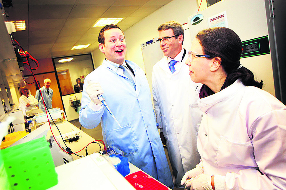 SCIENTIFIC: Ed Vaizey MP, left, with Milton Park managing director James Dipple and scientist Rebekka Krumbach.   Picture: OX64954 Ed Nix