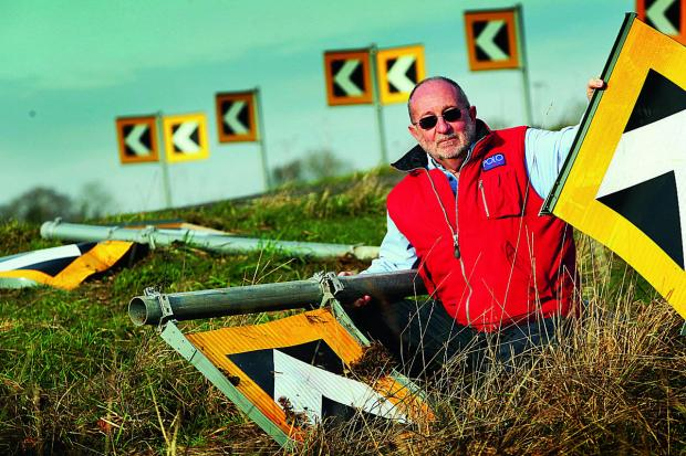 Spelsbury resident Trevor Taylor with the broken road signs on the B4026 north of the village. Picture: OX64779 Ed Nix