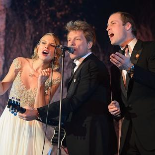 The Duke of Cambridge sings with Taylor Swift and Jon Bon Jovi at the Centrepoint Gala Dinner at Kensington Palace,