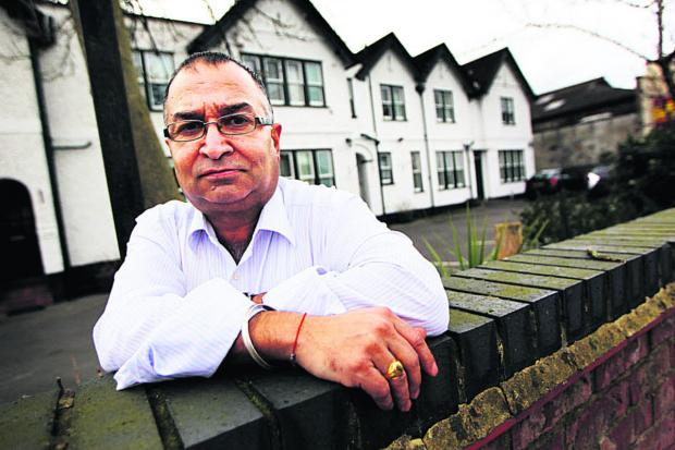 Abingdon Road guest house owner Narinder Bhella is bracing himself for more flooding. He said last month's floods wiped out a week of business. Picture: OX65074 Ed Nix