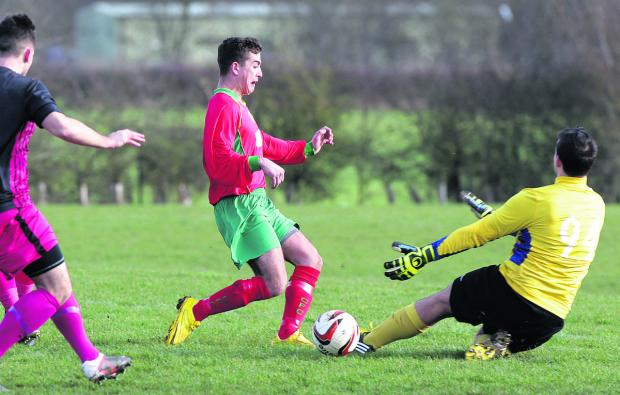 Witney Gazette: Carterton Rangers' keeper  Daniel Floyd is quickly off his line to deny the on-rushing Lee Moseley during their shock 4-3 win at home to Carterton Town A in the John Fathers Junior Shield on Saturday