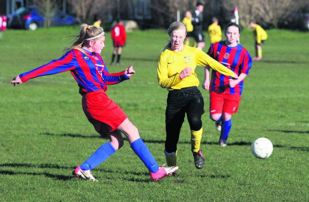 Witney Gazette: Tower Hill Vixens' Mollie Farr drives in a shot as Alana Jones tries to close her down during their 3-0 defeat at Benson in the