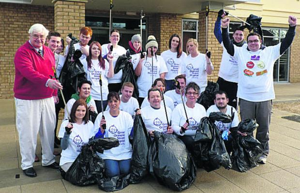 Councillor David Harvey, left, and hotel operations manager Sam Rowlands, right, with the litter-picking team from Witney's Premier Inn