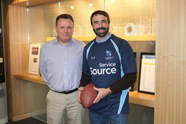 Witney Gazette: Oxfordshire Under 20 head coach presents Servicesource chairman and CEO Mike Smerko with a shirt highlighting the company's sponsorship
