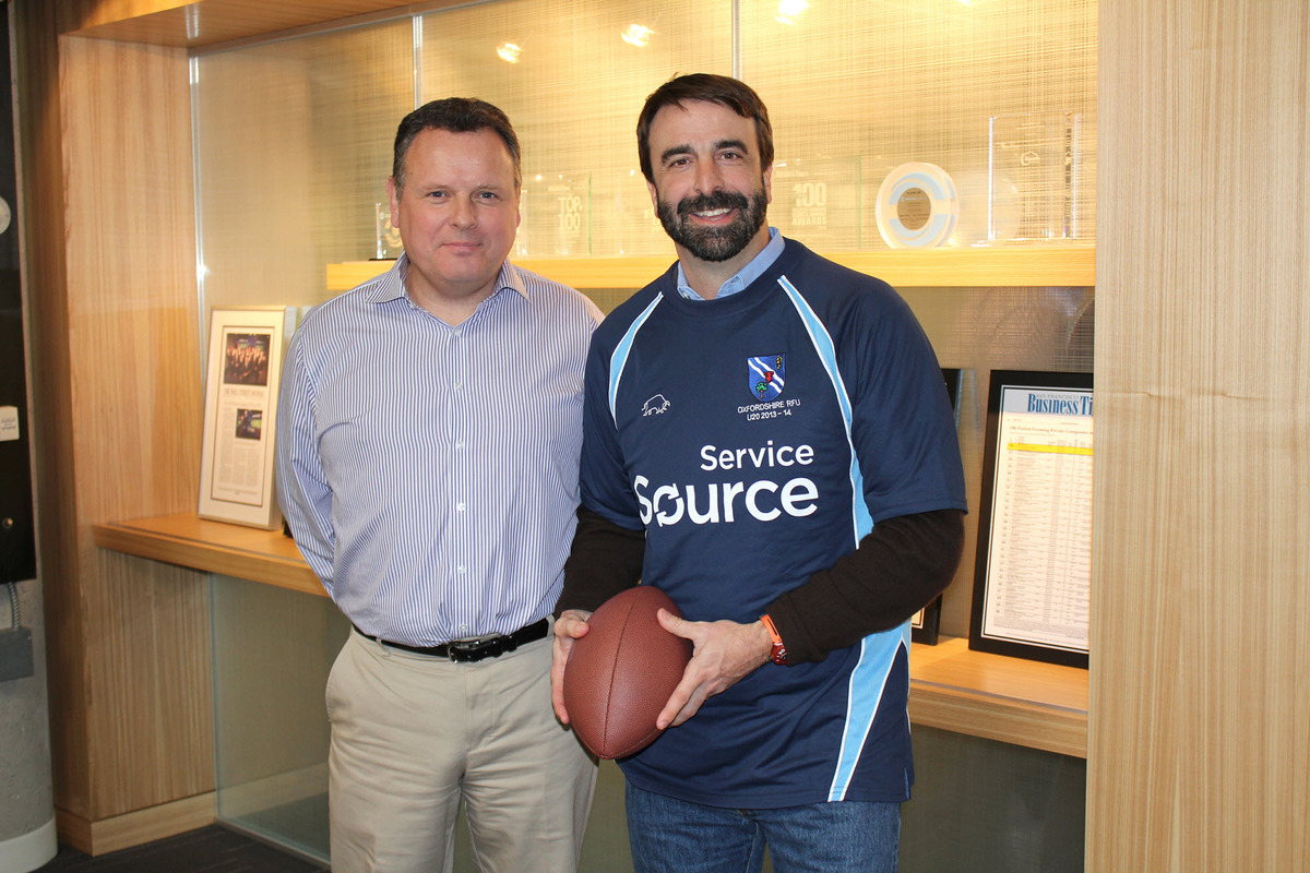 Oxfordshire Under 20 head coach presents Servicesource chairman and CEO Mike Smerko with a shirt highlighting the company's sponsorship