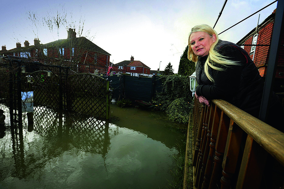 Jayne Madden surveys her flooded garden in Weirs Lane, off Abingdon Road, Oxford.