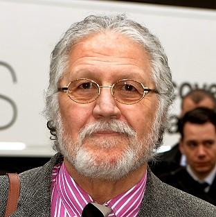 DJ Dave Lee Travis arrives at Southwark Crown Court in London, where he is accused of 13 counts of indecent assault and one count of sexual assault in