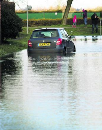 A car makes it way through floods in East Hanney