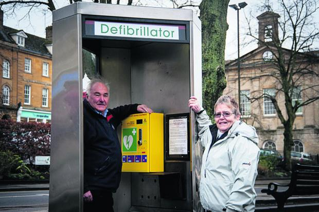 Mike Graham and Liz Nason with one of Chipping Norton's three defibrillator cabinets. Picture: OX65097 Aimee Kirkham
