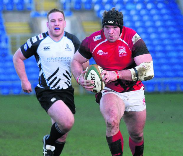 London Welsh prop James Tideswell powers through for their third try against Rotherham
