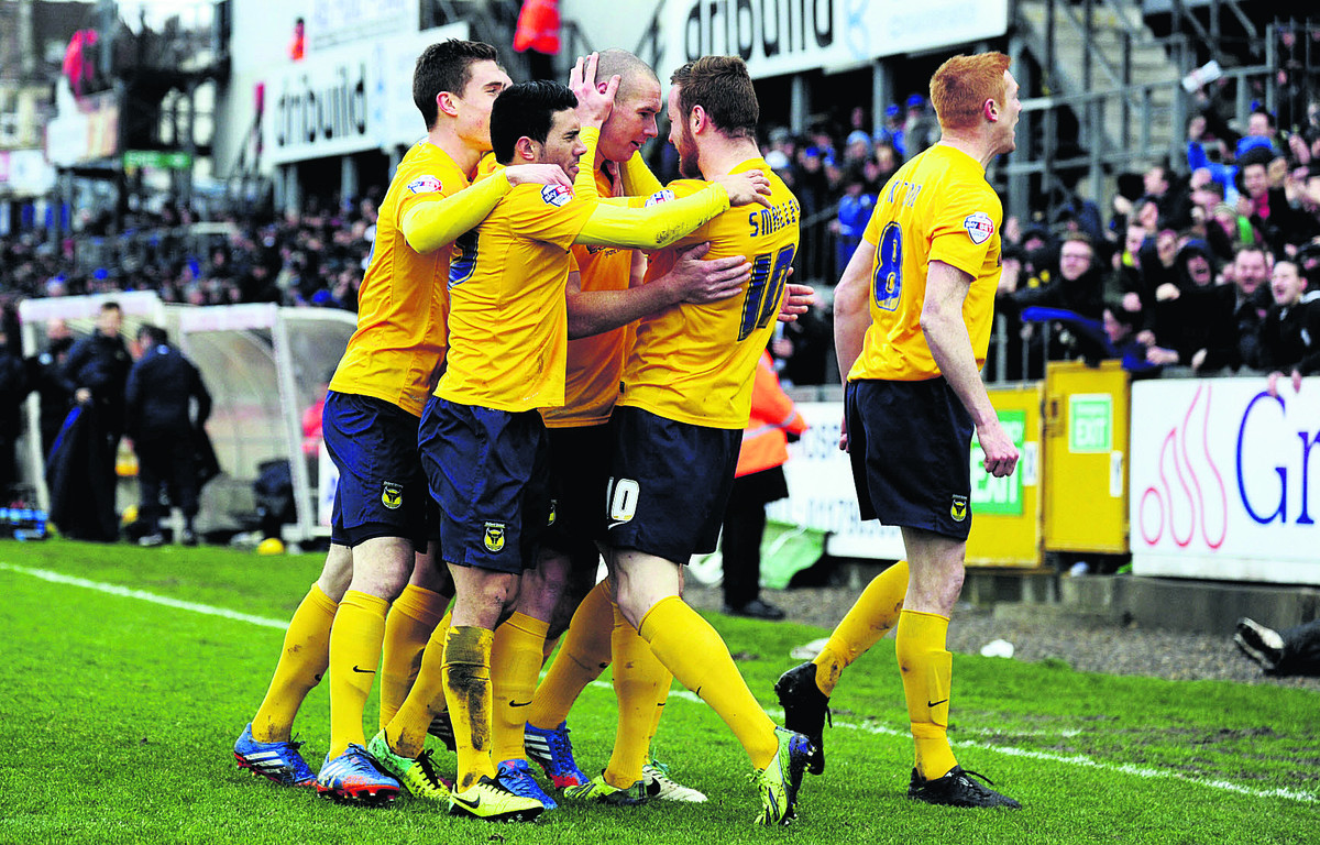 James Constable (centre) is surrounded by his Oxford United teammates after firing the U's ahead