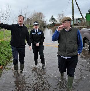Witney Gazette: Prime Minister David Cameron with Bridgwater and West Somerset MP Ian Liddell-Grainger (right) during a visit to Goodings Farm in Fordgate, Somerset