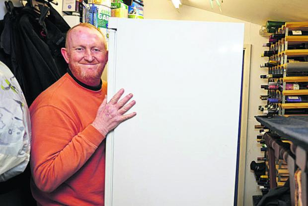 Witney Gazette: Mike Pearson, who lives in a caravan in Clifton Hampden, moves his possessions to higher ground