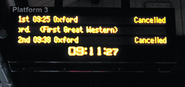 Didcot station information board showing cancelled train services to Oxford
