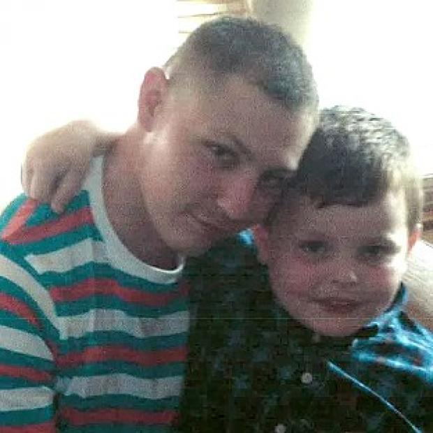 Witney Gazette: Dean Mayley, 24, hugging his seven-year-old nephew Callum