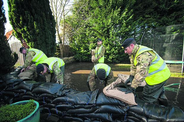 Troops from 32 Squadron build up a sandbag wall in South Hinksey