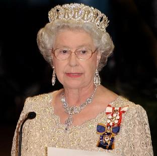 Witney Gazette: The Queen welcomed famous names such as John Hurt, Sir Roger Moore and Joan Collins to Buckingham Palce