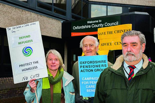 Showing their opposition yesterday, from left, Carol Stavris, Network of Oxford Women; Michael Hugh-Jones, Secretary of Oxford Pensioners Action Group; and Cllr David Williams of the Green Party. Picture: OX65403 Greg Blatchford