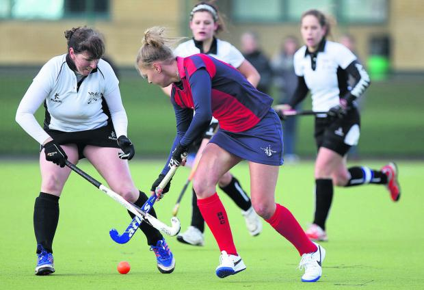 Witney's Tori Larkin tackles Banbury's Natasha Nunneley
