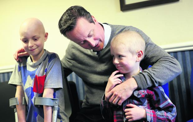 Prime Minister David Cameron meets Oxford Children's Hospital patients Finlay White, nine left, and Zac Durkin, five
