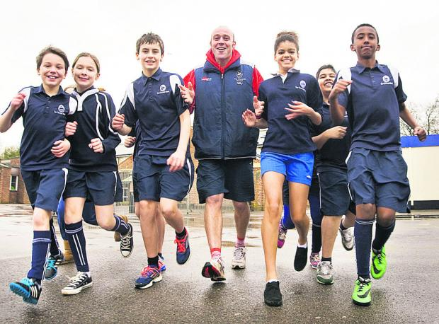 Witney Gazette: Cherwell School teacher Neil Busby with pupils, from left, Ben Jones, Lily Wooldridge, Adam Byles, Leila Al-Hassan, Liam Sagar and Jibril Mao-Mahad. Picture: OX65304 Antony Moore