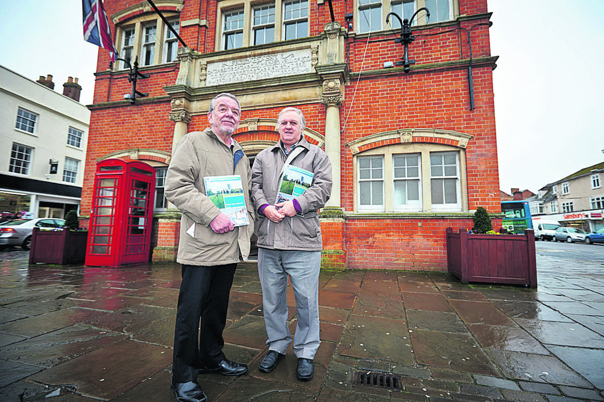 Councillors Mike Dyer, left, and David Bretherton, who led on the Thame Neighbourhood Plan, pictured with the approved document in front of the Town Hall. Picture: OX65635 Cliff Hide