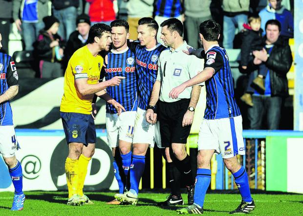 Jake Wright argues with referee Eddie Ilderton after Scott Hogan, who looked suspiciously offside, puts Rochdale ahead. The Oxford United skipper says the whole squad are desperate for Mickey Lewis to get the full-time manager's job
